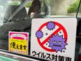 A COVID-19 sign is seen in a taxi outside the Azuma Baseball Stadium during the Tokyo 2020 Olympic Games softball tournament in Fukushima, Japan July 22, 2021.Picture taken July 22, 2021.