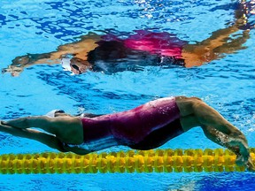 Canada's Kylie Masse competes in a heat of the women's 100M Backstroke during the swimming competition at the 2017 FINA World Championships in Budapest