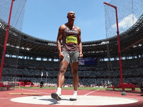 Damian Warner of Team Canada reacts while competing in the Men's Decathlon Discus Throw on day thirteen of the Tokyo 2020 Olympic Games at Olympic Stadium on August 05, 2021 in Tokyo, Japan.