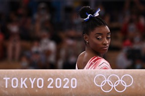 USA's Simone Biles gets ready to compete in the artistic gymnastics women's balance beam final of the Tokyo 2020 Olympic Games at Ariake Gymnastics Centre in Tokyo on August 3, 2021. (Photo by Lionel BONAVENTURE / AFP) (Photo by LIONEL BONAVENTURE/AFP via Getty Images)