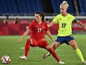 Canada's midfielder Jessie Fleming, left, fights for the ball with Sweden's midfielder Caroline Seger during the Tokyo 2020 Olympic Games women's final football match between Sweden and Canada at the International Stadium Yokohama in Yokohama on August 6, 2021.