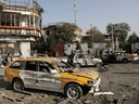 Damaged cars are seen at the site of a car bomb blast in Kabul, Afghanistan, on August 4, 2021. The Taliban has been resurgent since the recent withdrawal of American troops.