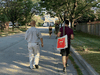 Liberal candidate Paul Chiang, left, walks alongside one of his volunteers in Markham Unionville, where the Liberals are trying to retake the riding from the Conservatives. Markham - Unionville is one of a handful of ridings in the GTA that did not go Liberal in 2019.