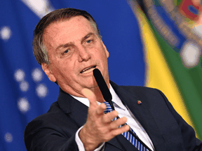 Critics say Jair Bolsonaro, like former U.S. president Donald Trump, is sowing doubts in case he loses the 2022 election.