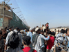 Crowds of people gather outside the airport in Kabul, Afghanistan August 23, 2021.