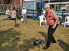 """Bloc Québécois MP Louis Plamondon plays a game of """"washer"""" with constituents at a seniors centre in his riding in Sorel-Tracy, Que."""