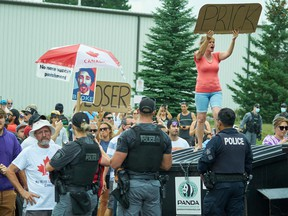 Protestors heckle Prime Minister Justin Trudeau during a Liberal campaign event in Cambridge, Ontario, on August 29, 2021. Photo by GEOFF ROBINS/AFP