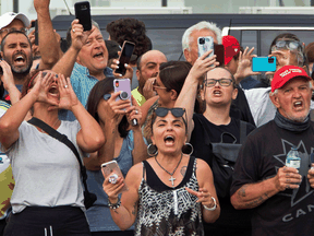 Protestors wait for Justin Trudeau to arrive for a campaign event in Bolton, Ont., on August 27, 2021. The event was cancelled over security concerns.