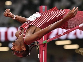 Qatar's Mutaz Essa Barshim competes in the men's high jump final during the Tokyo 2020 Olympic Games at the Olympic Stadium in Tokyo on August 1, 2021. (Photo by Ben STANSALL / AFP)