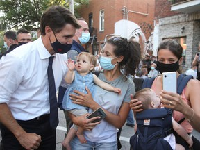 Justin Trudeau greets supporters during a campaign stop in his Papineau riding in Montreal on Aug. 15, 2021.
