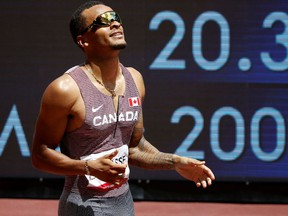Tokyo 2020 Olympics - Athletics - Men's 200m - Round 1 - Olympic Stadium, Tokyo, Japan - August 3, 2021. Andre De Grasse of Canada reacts after competing REUTERS/Phil Noble