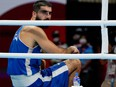 France's Mourad Aliev reacts after losing by disqualification against Britain's Frazer Clarke during their men's super heavy (over 91kg) quarter-final boxing match during the Tokyo 2020 Olympic Games.