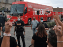 Protestors react as the media bus following Liberal Leader Justin Trudeau leaves after the cancellation of a campaign event in Bolton, Ontario, August 27, 2021.