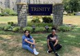 Anissa Young sits infront of Trinity University, where she received $11,000 in grants to pay off her academic loans.