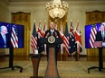U.S. President Joe Biden participates in a virtual press conference on national security with British Prime Minister Boris Johnson, right, and Australian Prime Minister Scott Morrison, in the White House in Washington, D.C., on Sept. 15.