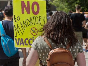 People protest the Ontario government's plan to introduce  vaccine passports, in front of Toronto City Hall on Sept. 1, 2021.