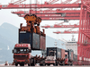 A crane loads a container onto a truck at Lianyungang Port in China on September 7, 2021.