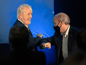 Conservative Leader Erin O'Toole is introduced by former prime minister Brian Mulroney during a campaign rally in Orford, Que., on September 15, 2021.