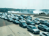 Cars line up on the Rainbow Bridge before crossing the border into Canada, in Niagara Falls, Ont.