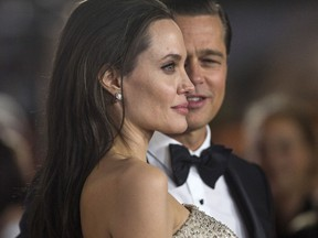 Director and cast member Angelina Jolie and her husband and co-star Brad Pitt pose at the premiere of 'By the Sea' in Hollywood, Calif. in 2015.