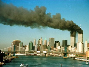 Smoke is seen at the towers of the World Trade Center shortly after being struck by a hijacked commercial aircraft, in New York, U.S., September 11, 2001.