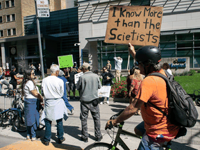 Demonstrators gather outside Toronto General Hospital, on September 13, 2021, to protest against COVID-19 vaccines, COVID-19 vaccine passports and COVID-19 related restrictions.