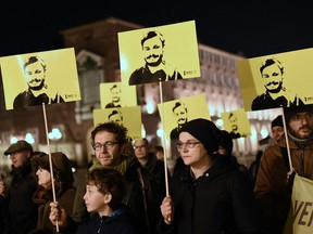File: Activists of human rights organization Amnesty International (AI) take part in a demonstration in Piazza Castello in Turin, to mark the fourth anniversary since the disappearance of Italian student Giulio Regeni.