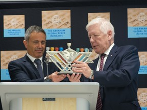 Avi Benlolo, left, presents an award to Bob Rae, Canada's ambassador to the UN, at the launch of the Abraham Global Peace Initiative in New York on Oct. 6.