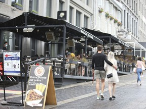 People walk past an outdoor restaurant in downtown Montreal on June 5, 2021. The effects of Quebec's Bill 96 on Montreal's commercial life will be stultifying, predicts Barbara Kay.