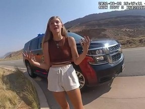 In this August 12, 2021, still image from a police bodycam released by the Moab City Police Department in Utah, Gabrielle Petito speaks with police as they responded to an altercation between Petito and her boyfriend, Brian Laundrie. (Moab City Police Department/AFP)