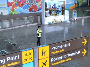 An officer stands at Ngurah Rai International Airport in Badung, Bali, Indonesia, on Oct 14.