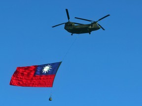 A Taiwan flag is carried across the sky during a rehearsal on October 5, 2021, for national day in Taipei, Taiwan.