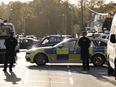 Police officers at the scene of the fatal stabbing of Conservative British lawmaker David Amess at Belfairs Methodist Church in Leigh-on-Sea, a district of Southend-on-Sea, in southeast England on October 15, 2021.