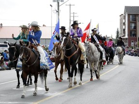 Various members of rodeo royalty wave to onlookers of the 2016 Labour Day Parade in Cochrane, Alta. on Monday, Sept. 5, 2016. (David Feil/Cochrane Times/Postmedia Network)