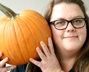 Jessica Laidley, food resource centre co-ordinator at Harvest Algoma, holds a pumpkin in Sault Ste. Marie, Ont., on Tuesday, Oct. 30, 2018. (BRIAN KELLY/THE SAULT STAR/POSTMEDIA NETWORK)
