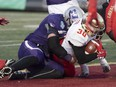 Laval Rouge et Or's Alexis Cote dives in the end zone to score the last touchdown against the Western Mustangs at the Vanier Cup in Quebec City, Saturday, Nov. 24, 2018. Laval won 34-20. Mustangs' Austin Fordham-Miller is on Cote's back. THE CANADIAN PRESS/Jacques Boissinot