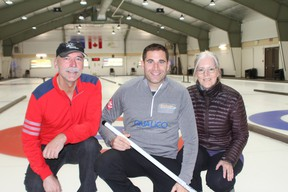 (Left to right) Rocky Mountain Curling Association's John Graham, two-time Olympic Curling gold medalist John Morris and Kathy Seifert pictured at the Canmore Golf & Curling Club after they announced the Qualico Mixed Doubles Classic on November 20. Photo credit Marie Conboy.