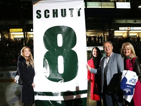 Former Sudbury Wolves player Rod Schutt and his wife, Rita, and daughters, Christen and Megan, take part in a pre-game ceremony at the Sudbury Community Arena in Sudbury, Ont. on Friday November 2, 2018. Schutt's number 8 was raised to the rafters.
