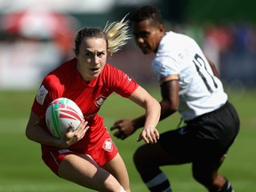 Julia Greenshields of Canada runs with the ball on Day 1 of the Emirates Dubai Rugby Sevens - HSBC World Rugby Sevens Series at The Sevens Stadium  on November 29, 2018, in Dubai, United Arab Emirates.  (Francois Nel/Getty Images)
