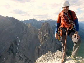 Tim Auger at the summit of Banff's Mount Louis, one of his favourite challenges. This photo was taken after the last time he climbed it. He climbed the route via homage to the Spider, which he first did in 1988. Photo credit Brandon Pullan.