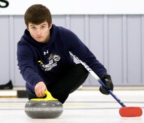 Ursuline Lancers skip Alex Jeromel throws a rock during the SWOSSAA boys' curling final against the St. Patrick's Fighting Irish at the Golden Acres Curling Club in Blenheim, Ont., on Monday, March 4, 2019. Mark Malone/Chatham Daily News/Postmedia Network