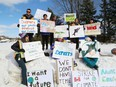 Climate change protesters take part in a rally at the entrance to Laurentian University in Sudbury, Ont. on Friday March 1, 2019.
