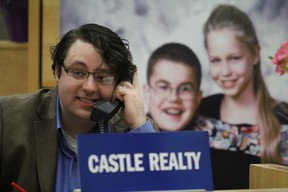 A volunteer takes a call during the Easter Seals telethon at Civic Centre in Sault Ste. Marie, Ont., on Sunday, March 30, 2014. (BRIAN KELLY/THE SAULT STAR/POSTMEDIA AGENCY)