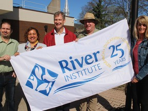 At the flag-raising ceremony on Monday morning with Mayor Bernadette Clement are the River Institute's (from left) Louis Savard (program leader, RiverLabs), Dr. Jeff Ridal (executive director, chief research scientist), Dr. Brian Hickey (program leader, Education/research scientist) and Christina Collard (program leader Administration and Fundraising). Photo on Monday, May 6, 2019, in Cornwall, Ont. Todd Hambleton/Cornwall Standard-Freeholder/Postmedia Network