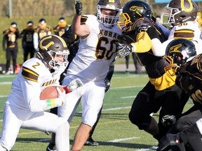 PETER RUICCI/Sault Star Korah's Tyler Brechin runs inside for yardage against Sudbury's Lively Hawks in the 2018 NOSSA senior football semifinal. The Colts stopped the Hawks 52-23 and went on to win the NOSSA title.