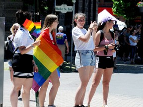 South Grenville District High School students, from left, Gaia Sisto, Sierra Letts, Laura Calderon and Valentina Targa wave in support of the 2019 Pride Parade in Brockville. (FILE PHOTO)