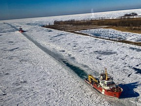 CCGS Samuel Risley is shown in this file photo, provided by the Canadian Coast Guard, clearing a path in the ice in the St. Clair River during a previous winter.