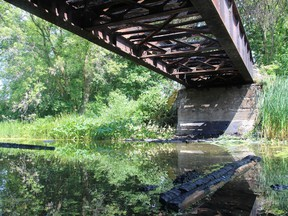 A view from underneath the Peanut Line trail bridge showing the metal structure on Thursday August 8, 2019 in Bridge End, Ont. Alan S. Hale/Cornwall Standard-Freeholder/Postmedia Network