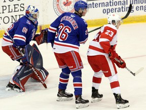 Soo Greyhounds centre Rory Kerins (right) and Kitchener Rangers defenceman Ville Ottavainen watch the play in front of Rangers goaltender Jacob Ingham during first-period OHL play at GFL Memorial Gardens Friday, Sept. 27, 2019 in Sault Ste. Marie, Ont. JEFFREY OUGLER/THE SAULT STAR/POSTMEDIA NETWORK