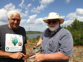 Professors Peter Beckett (left) and Graham Speirs from Laurentian University are pioneers within Sudbury's regreening efforts. With the Superstack in the background, they presented to a Canadian Ecology Centre's mining teachers tour in September of last year.